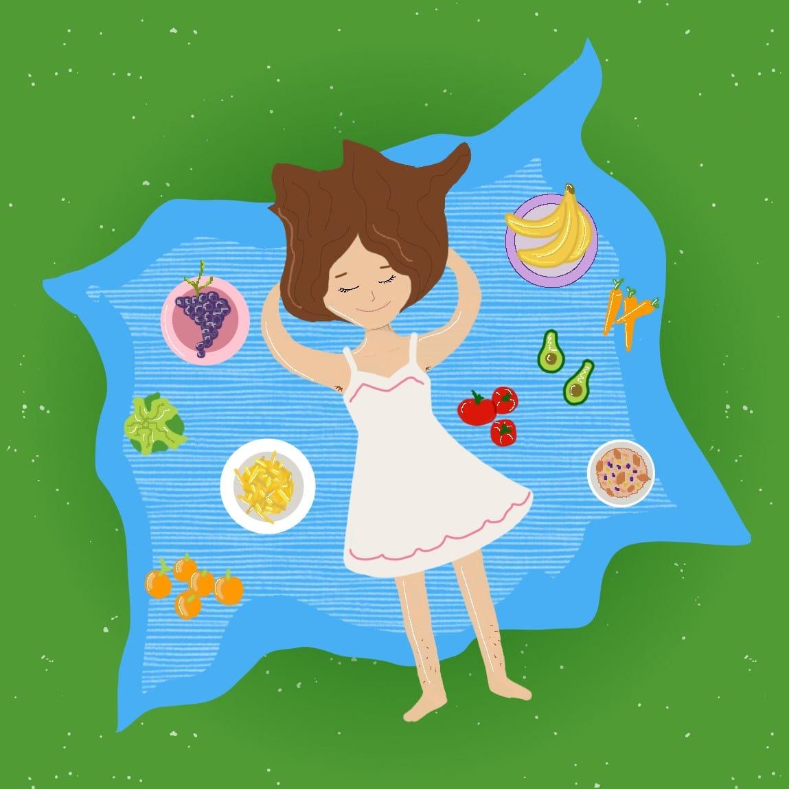 Mujer haciendo un picnic con alimentos veganos